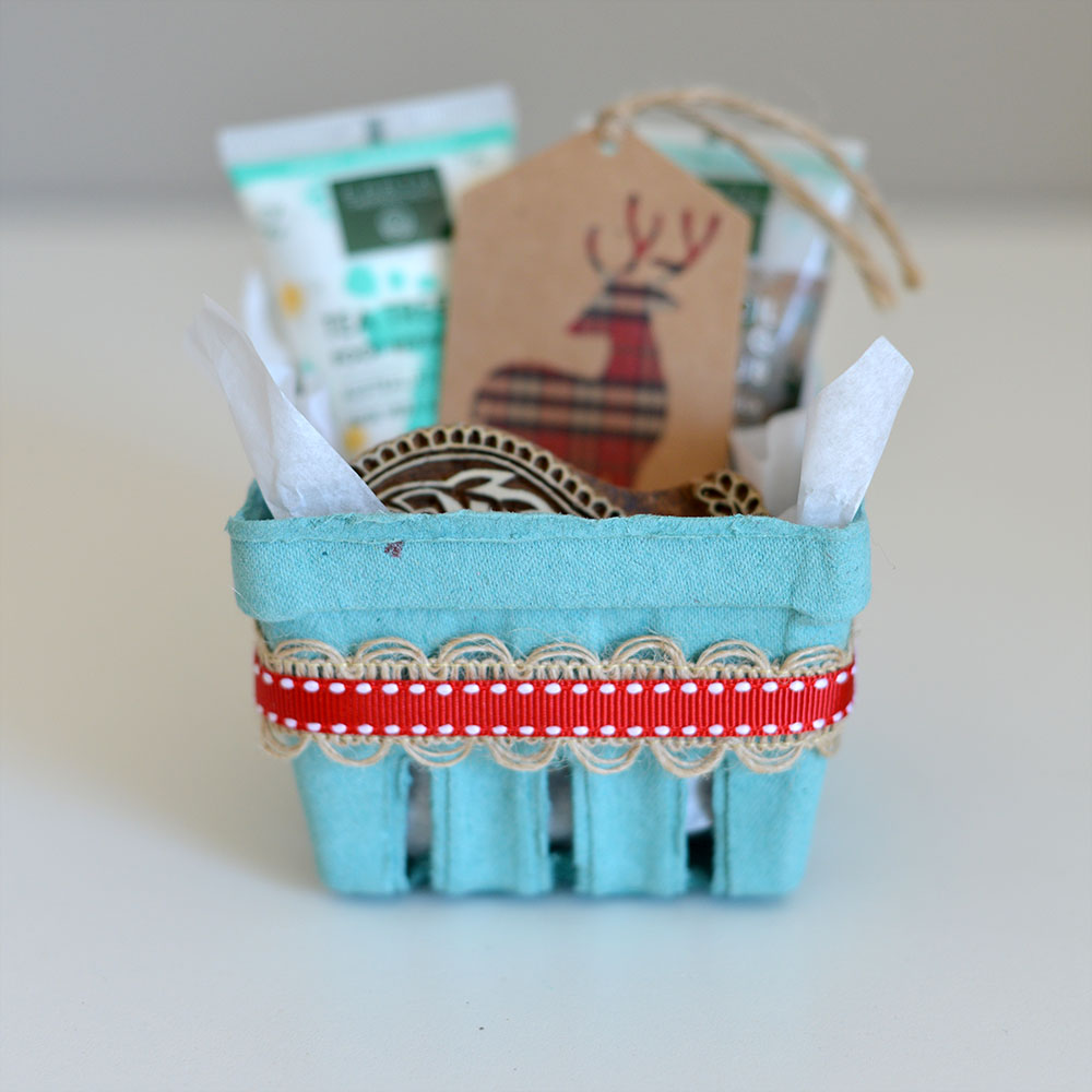 Green Berry basket with a cute little Christmas gift inside
